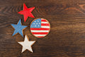 Cookies with american patriotic colors round shaped and stars on the wooden background Stock Photos