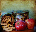 Cookies and apple food on the table two red apples homemade in vintage metal decorated box Stock Photo