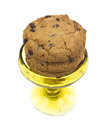 Cookies in blown glass goblet several chocolate chip with nougat filling an old on a white background Stock Image