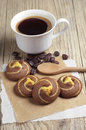 Cookies with chocolate and coffee cup on rustic wooden table Royalty Free Stock Image