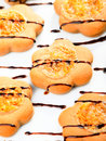 Cookies with chocolate toppling shot from above Stock Images