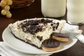 Cookies and cream pie with milk a slice of a bottle of Royalty Free Stock Image
