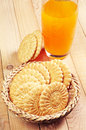 Cookies and glass of juice Stock Photography