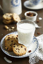 Cookies with a glass of milk rum and raisins Stock Photo