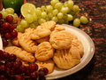 Cookies with grapes and fruit surrounded by other fruits Royalty Free Stock Image