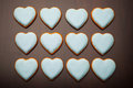 Cookies hearts multitude of on brown background Royalty Free Stock Images