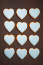 Cookies hearts multitude of on brown background Royalty Free Stock Image