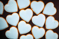 Cookies hearts multitude of on brown background Stock Image
