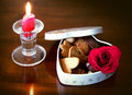 A cookies  heartshaped box, a candle and a rose Stock Images
