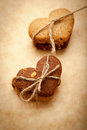 Cookies homemade in the shape of hearts tied with a rope Royalty Free Stock Images