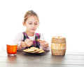 Cookies with honey girl eats Royalty Free Stock Images