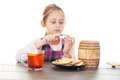 Cookies with honey from a wooden keg girl eats Stock Photography