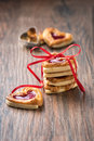 Cookies  with Jam on a rustic wooden Table Royalty Free Stock Photo