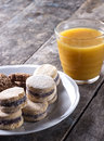 Cookies and juice on old wooden table close up Stock Photo
