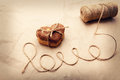 Cookies love letter written by a thread and home baked in the shape of heart Royalty Free Stock Photo