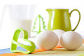 Cookies making: eggs, jug, cookie forms  Royalty Free Stock Photos