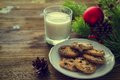 Cookies and milk for Santa Clause on wood background Royalty Free Stock Photo