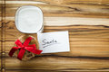 Cookies and milk for santa view form a above at a stack of a glass with with a white note Royalty Free Stock Image