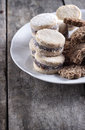 Cookies on plate on old wooden table Royalty Free Stock Image