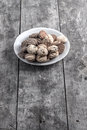 Cookies on plate on old wooden table Royalty Free Stock Photography