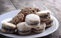 Cookies on plate on old wooden table close up Royalty Free Stock Photos