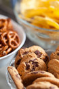 Cookies and pretzels in bowls, shallow DOF Stock Images