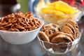 Cookies and pretzels in bowls, shallow DOF Stock Photography