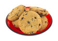 Cookies on red dish several chocolate chip gourmet a Stock Images