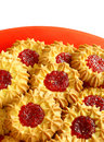 Cookies on red plate isolated on white Stock Image
