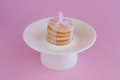 Cookies with satiny tape on pink background frosting white white plate Stock Photos