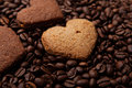 Cookies in the shape of heart on coffee beans Royalty Free Stock Images
