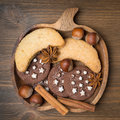 Cookies spices and nuts on a wooden plate close up Royalty Free Stock Photo