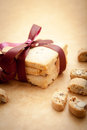 Cookies stack of homemade tied with a burgundy ribbon on brown background Stock Photo