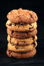 Cookies in a stack isolated on black Stock Photo