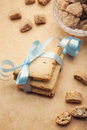 Cookies and sugar stack of homemade tied with a blue ribbon on brown background Stock Image