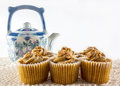 Cookies and teapot arrangement of a decorated in the background on the table Stock Photos