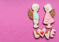 Cookies with the text of love and angels couple on valentine s day Royalty Free Stock Photos