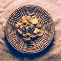 Cookies in wicker plate vintage design canvas fabric Royalty Free Stock Photo