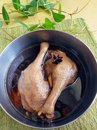 Cooking asian cuisine braised duck leg a photograph showing two drum sticks of legs in a metal braising stewing pot made from Royalty Free Stock Photography