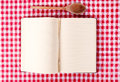 Cooking book blank and wooden ladle from above Stock Image