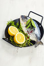 Cooking fish fresh dorado and vegetables on wooden board food and drink Royalty Free Stock Photo