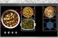 Cooking Food on a Gas Stove top panoramic view Royalty Free Stock Photo