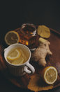 Cooking ginger, lemon and honey hot tea at home. Royalty Free Stock Photo