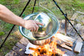 Cooking goulash or stew outdoors in cast-iron cauldron. Royalty Free Stock Photo