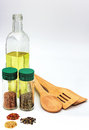 Cooking ingredients and utensils such as spices herbs olive oil with a set of Royalty Free Stock Photos