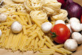 Cooking with italian ingredients Royalty Free Stock Photo