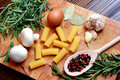 Cooking macaroni ingredients spices egg  rosemary Royalty Free Stock Photo