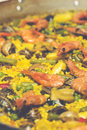 Cooking paella is a typical spanish rice food is now ready to eat preparing vintage set Stock Image