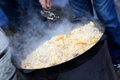 Cooking pilaf in the outdoor uzbek restaurant Royalty Free Stock Images