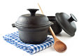 Cooking pots kitchenware and wooden spoon Royalty Free Stock Image